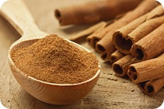 Cinnamon sticks and powder, studio shot, wood background,